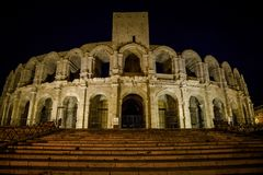 Amphitheatre at night, Arles, Bouches-du-Rhone, France stock images
