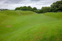 Roman amphitheatre remains Cirencester Gloucestershire South Wes. Earthwork remains of the Roman amphitheatre, one of the largest Roman amphitheatres in Britain Stock Photo