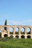 A Roman antique aqueduct Stock Images