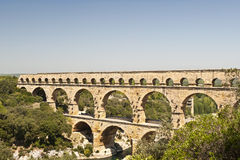 The Roman Aquaduct - Pont du Gard. The Roman Aquaduct Pont du Gard in France from atop a nearby hill Royalty Free Stock Photography