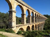 Roman Aqueduct in the Afternoon Sun. A Roman aqueduct in Northern Spain on a clear day in the afternoon sun Royalty Free Stock Images