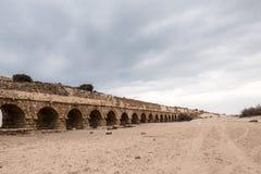 Roman Aqueduct. The Roman aqueduct along the shoreline of the Mediterranean Sea at Caesarea Maritima in Israel Royalty Free Stock Photography