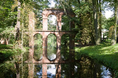 The roman aqueduct in the Arkadia park in Poland. The Arkadia park is the known romantic English landscape garden in Poland. The aqueduct is one of many romantic royalty free stock photo