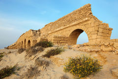 Roman aqueduct in Ceasar. Classic Israel - Sundown at old Ancient Roman aqueduct in Ceasarea at the coast of the Mediterranean Sea Royalty Free Stock Photography