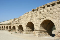 Roman aqueduct in Israel. Remains of the ancient Roman aqueduct that brought water to the city of Caesarea (Israel) from springs at the foot of Mount Carmel Royalty Free Stock Images