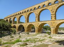 Ancient Roman aqueduct Pont du Gard in southern France. Roman aqueduct known as Pont du Gard, a magnificent bridge to carry water over the Gardon River. Most Royalty Free Stock Photo