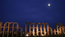 Roman aqueduct of Merida at moonlight Stock Image
