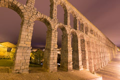 Roman Aqueduct in night. Segovia, Spain Stock Photography