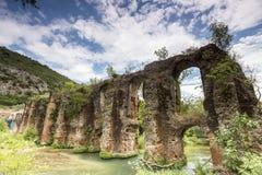 Roman aqueduct of Nikopolis against beautiful cloudy sky in Gree Stock Photos