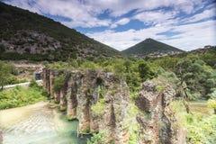 Roman aqueduct of Nikopolis against beautiful cloudy sky in Gree Royalty Free Stock Image