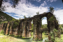 Roman aqueduct of Nikopolis against beautiful cloudy sky in Gree Royalty Free Stock Photos