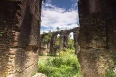 Roman aqueduct of Nikopolis against beautiful cloudy sky in Gree Stock Photography