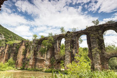 Roman aqueduct of Nikopolis against beautiful cloudy sky in Gree Stock Photo