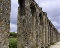 Roman Aqueduct. Old Roman aqueduct outside of the walled city of Obidos, Portugal Stock Images