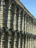 Roman Aqueduct Ruins. Ruins of the Roman Aqueducts against a blue sky stock photo