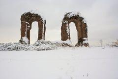 Roman aqueduct ruins and snow Stock Photo
