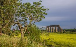 Roman aqueduct ruins. View of ancient roman aqueduct ruins during spring season in Rome countryside Stock Photo