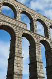 Roman Aqueduct of Segovia. Detail of the Roman Aqueduct of Segovia on a clear blue sky Stock Photography