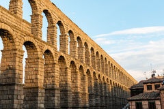 Roman aqueduct of Segovia at dusk Stock Image