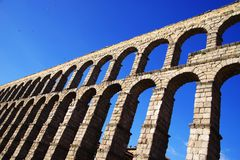 The Roman aqueduct of Segovia - the most important architectural landmark of Segovia. The Aqueduct of Segovia or more accurately, the aqueduct bridge is a Roman stock photo