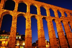 The Roman aqueduct of Segovia at night - the most important architectural landmark of Segovia. The Aqueduct of Segovia or more accurately, the aqueduct bridge is royalty free stock images