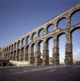 Roman Aqueduct, Segovia, Spain. Roman Aqueduct in Segovia , Spain, 20400 blocks was used without mortar or concrete and highest point is 100 feet Royalty Free Stock Images