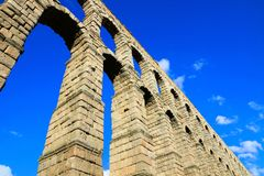 Roman Aqueduct of Segovia, Spain under blue skies Royalty Free Stock Image