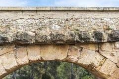 Roman aqueduct in Tarragona, Spain. Detail of an arch of the roman aqueduct called Pont del Diable in Tarragona, Catalonia, Spain Stock Images