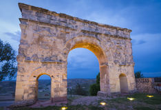 Roman arch of Medinaceli in Soria province, Castilla-Leon, Spain. Roman arch of Medinaceli, from 2nd-3rd century AD in Soria province, Castilla-Leon, Spain. Blue stock photo