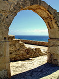 Roman Arch Portrait. Classical Roman arch at the Kourion archeological site near Paphos, Cyprus
