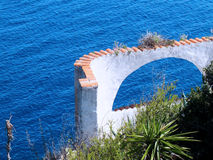 Roman arch on sea Stock Images