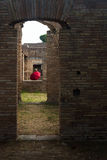 Roman arches with red umbrella Ostia Antica Italy Royalty Free Stock Image