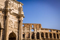 Roman architecture. View of old roman architecture in Rome, Italy. The arch of Constantine and Colosseum in background Stock Image