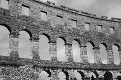 Roman Arena in Pula Croatia. Dramatic black and white (monochrome) of the ancient Roman ruins of the Pula Amphiitheater in Pula, Croatia. This image was taken in Royalty Free Stock Image