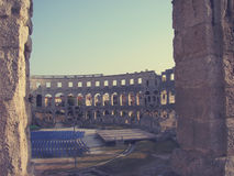 Roman Arena in Pula, Croatia, on a sunny day; faded, retro style Royalty Free Stock Photography
