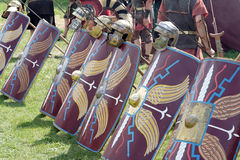 Roman army. Shields and weapons of roman legionaries Stock Photos