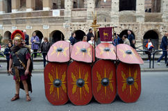 Roman army battle array near colosseum at ancient romans historical parade. Roman army near colosseum at ancient romans historical parade for the birth of city Royalty Free Stock Image