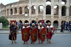 Roman army battle array near colosseum at ancient romans historical parade. Roman army near colosseum at ancient romans historical parade for the birth of city Royalty Free Stock Photo
