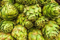 Roman artichokes at farmers market. Background. Royalty Free Stock Photo
