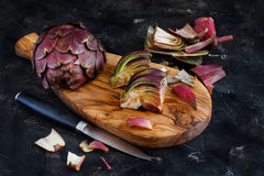 Roman Artichokes on a wooden board Royalty Free Stock Photography