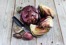 Roman Artichokes on a wooden board Royalty Free Stock Images