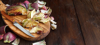 Roman Artichokes on a wooden board Stock Images
