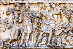 The Roman bas-relief. Roman bas-relief in the ancient stone walls Royalty Free Stock Photography