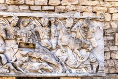 The Roman bas-relief. Roman bas-relief in the ancient stone walls Royalty Free Stock Photos