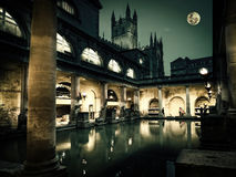 Roman Baths. The Roman Baths in historic Bath, England. The torches are lit only for a short period of time in winter to give an impression of how the baths Stock Photography