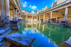 Roman Bath, England. BATH, ENGLAND - JULY 8, 2014: inside of Roman Baths with unidentified people, which is a site of historical interest in the city of Bath Royalty Free Stock Photography