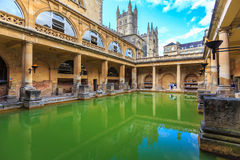 Roman Bath, England. BATH, ENGLAND - JULY 8, 2014: inside of Roman Baths with unidentified people, which is a site of historical interest in the city of Bath Royalty Free Stock Image