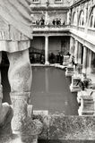 Roman Bath House, Bath UK. Roman Statue in foreground royalty free stock photography