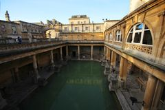 Roman Bath, UK - December 6, 2013: Tourists visiting inside Roman Baths complex. City of Bath is a UNESCO World Heritage Site. Se