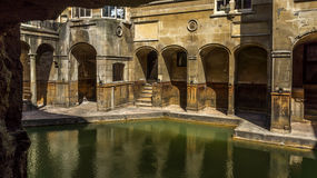 Roman baths in Bath. An ancient roman bath in the city of Bath England Stock Photos